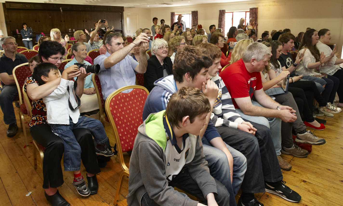 Family members pictured at the Aspiro end of Summer Camp performance in the Eire Og GAA clubhouse. Pic: Michael O\'Rourke